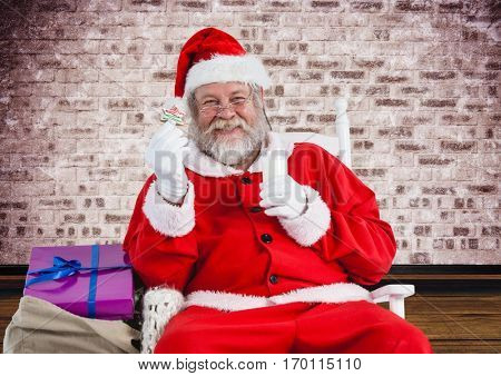 Portrait of smiling santa claus holding glass of milk and christmas cookies with sack of gift