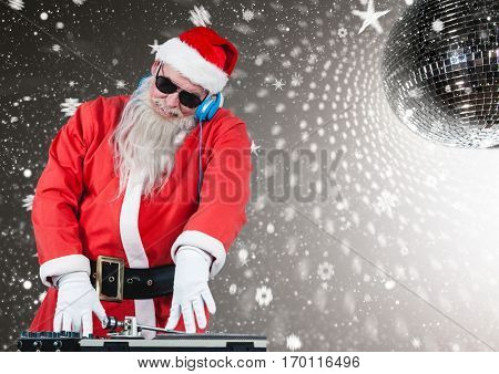 Santa playing dj in disco during christmas time