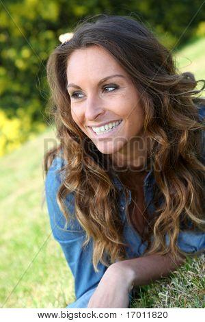 Portrait of beautiful woman relaxing in home garden