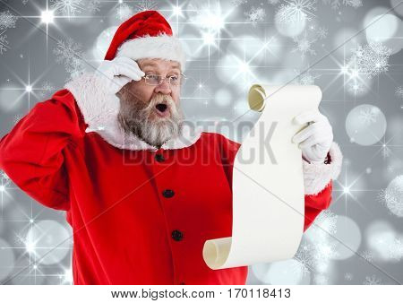Santa claus reading wish list against digitally generated background