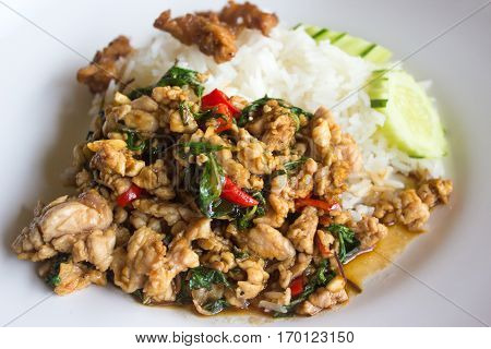 Thai dish close up rice topped with stir fried minced pork and basil