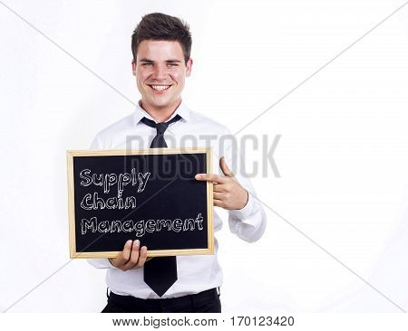 Supply Chain Management Scm - Young Smiling Businessman Holding Chalkboard With Text