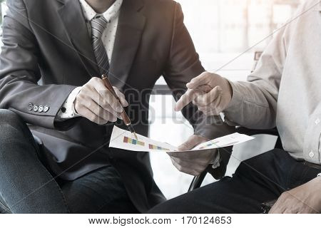 Business adviser analyzing financial figures denoting the progress in the workconsult concept.