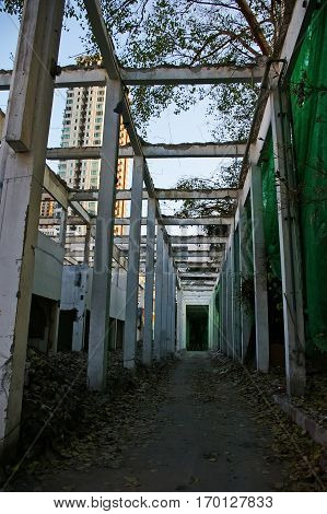 Old abandoned industrial among the city in Thailand