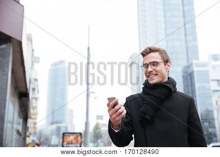Portrait of business man with phone on the street. man looking at phone