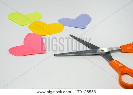 use scissors cut postit paper as heart