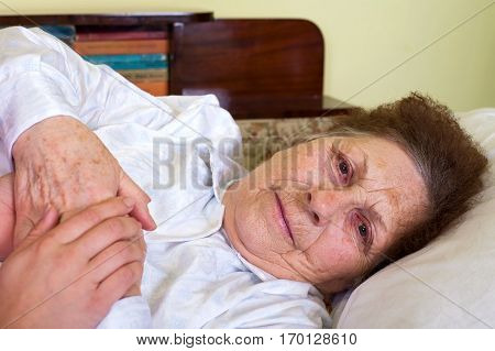 Picture of a bedridden elderly woman at home