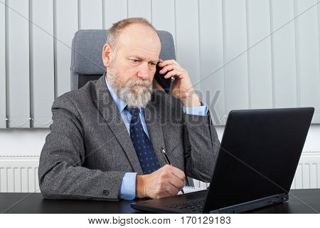 Picture of a thoughtful employer having a phone call