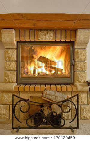 Roaring flames in modern fireplace, close up
