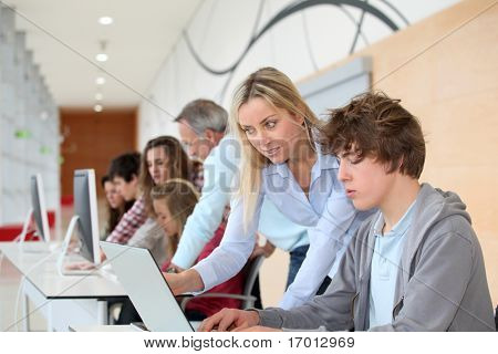 Group of students attending training course at school
