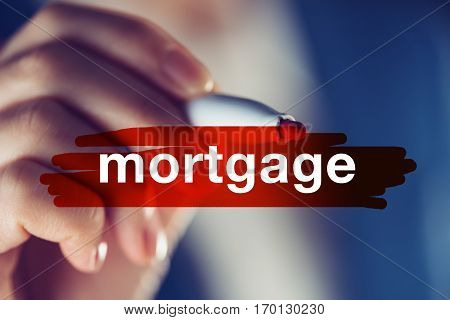 Business mortgage concept businesswoman highlighting word with red marker pen