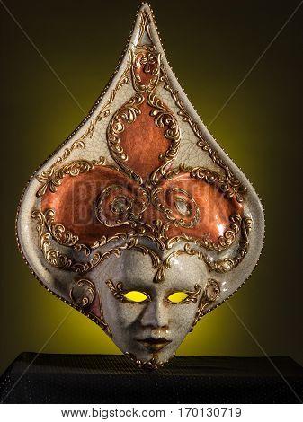 Beauty Venetian mask isolated on black and yellow background