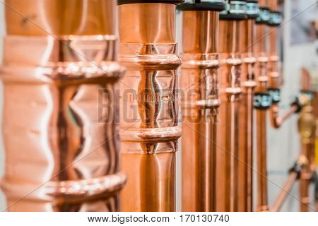Brilliant new copper pipes. Connection of copper pipes blooming fitting.
