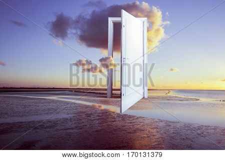 Conceptual surrealistic door open on calm ocean with sunset window to freedom