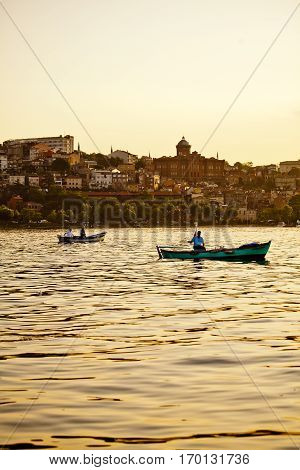 Fishing boats in the sunset in strait of Bosphorus, Istanbul, Turkey