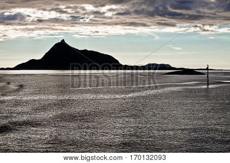 Summer Norwegian Landscape with sea and mountain in the midnight sun