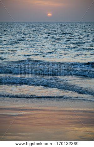 Pale romantic sunset on the ocean, Senegal, Africa