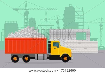 Trucking on construction vector concept. Tipper loaded with concrete bricks, building site, silhouettes of buildings and cranes on background. For construction theme illustrating, building company ad