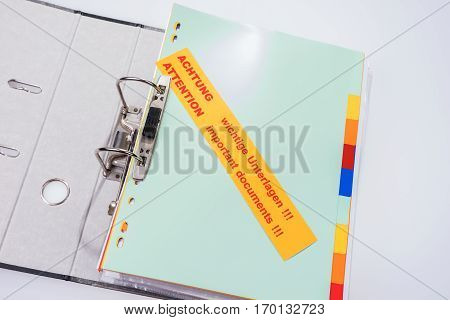 Folder with label - Attention Important documents !!! - in English and German
