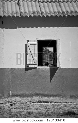 window of an African building with open window and corrugated iron roof Senegal