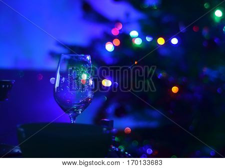 One Empty Wine Glass And Abstact Night Blury Defocus Bokeh Light Background Photography