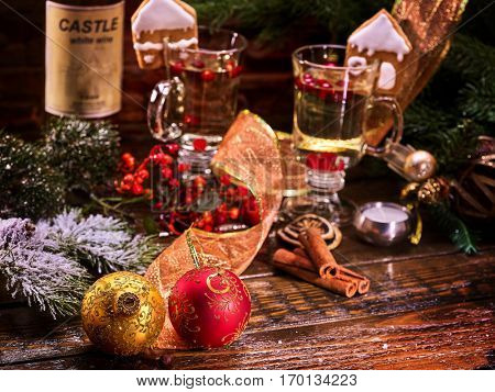 Christmas still life with mulled wine and cinnamon on a wooden table.