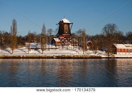 Swedish landscape with old wooden windmill near Stockholm, sweeden