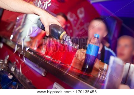 Barman prepares cocktail at the night club.