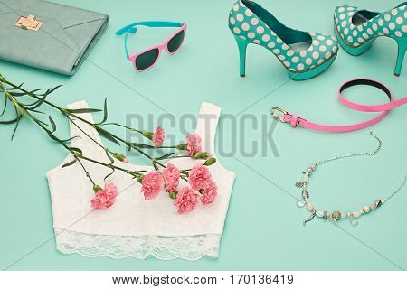 Fashion Design Spring girl clothes set, accessories. Trendy sunglasses, lace top, fashion handbag clutch, flowers.Glamor shoes heels.Summer lady.Creative urban.Pastel spring colors.Perspective view