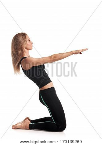 Pretty fit slim woman standing in yoga pose