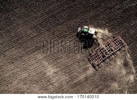 tractor plowing field, top view, aerial photo
