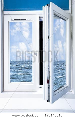 Surrealistic window opened on a blue ocean with blue sky and white clouds, inspired by Magritte