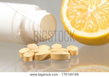 Flu prevention Vitamin c pill and lemon