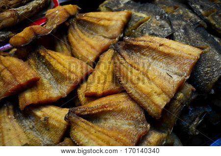 Closeup fried fish in the fresh market