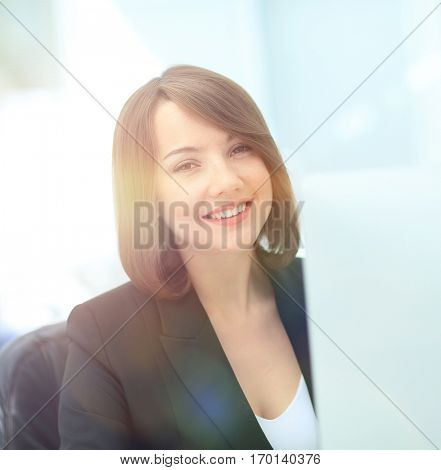 Beautiful business woman dreaming while working on computer at h