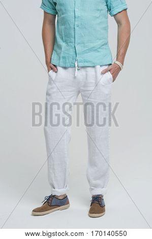 handsome man pants shirt in the studio