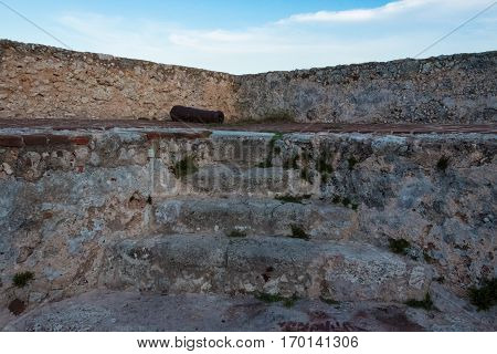 Santiago de Cuba, Cuba- December 3, 2016: St. Peter of the Rock Military Fortress. Stone and rubble walls stairs centered in between the two walls The place is a Unesco World Heritage Site