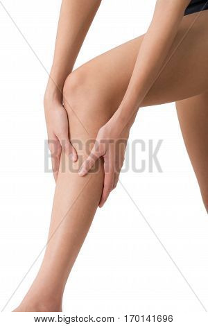 woman holding her beautiful healthy long leg with massaging shin and calf in pain area Isolated on white background.
