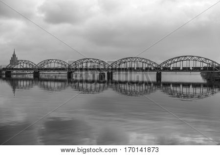 Picturesque view over the metal Railway Bridge over the Daugava river in Riga Latvia