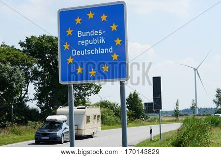 Photo with German border sign on the road.