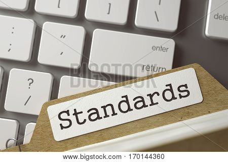 Standards Concept. Word on Folder Register of Card Index. Card File Concept on Background of Modern Metallic Keyboard. Closeup View. Blurred Toned Image. 3D Rendering.