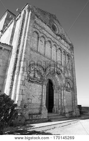 black and white view of front facade of Sainte-Radegonde medieval Church Talmont sur Gironde Charente Maritime France