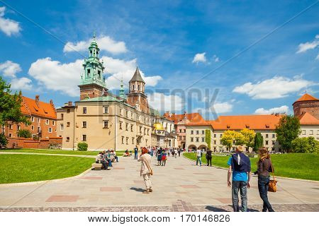 Krakow, Poland - June 08, 2016: Tourists Heading Towards Historical Complex Of Wawel Royal Castle An