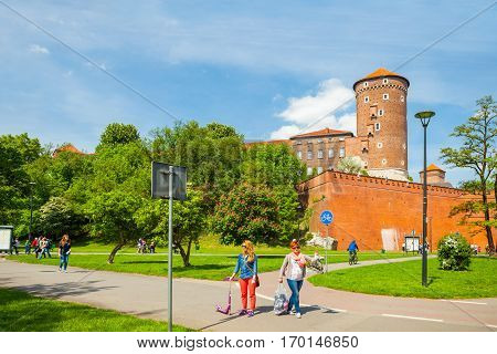 Krakow, Poland - June 08, 2016: Tourists Walking Near Historical Complex Of Royal Wawel Castle With