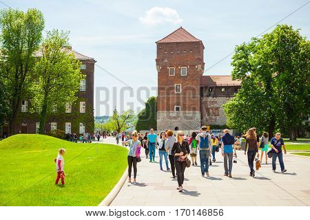 Krakow, Poland - June 08, 2016: Lots Of Tourists Passing The Entry Path To Historical Complex Of Waw