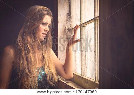 Beautiful woman looking out window