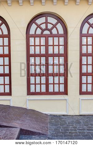 Retro style of architecture building detail of vintage brown window frame on upstairs exterior wall building house.