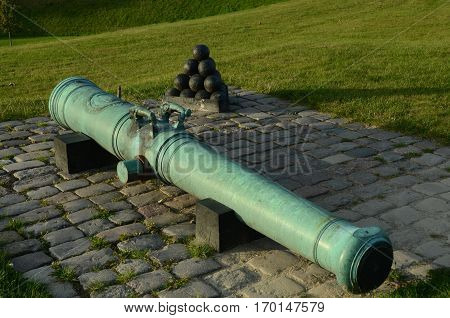 An old cannon and cannon balls on the castle ramparts in Copenhagen