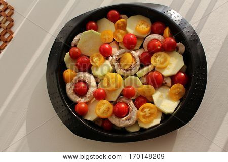 Roasted vegetables with mushrooms in the oven