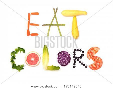 Eat colors - text spelled out in colorful plant foods; concept of healthy eating, on white